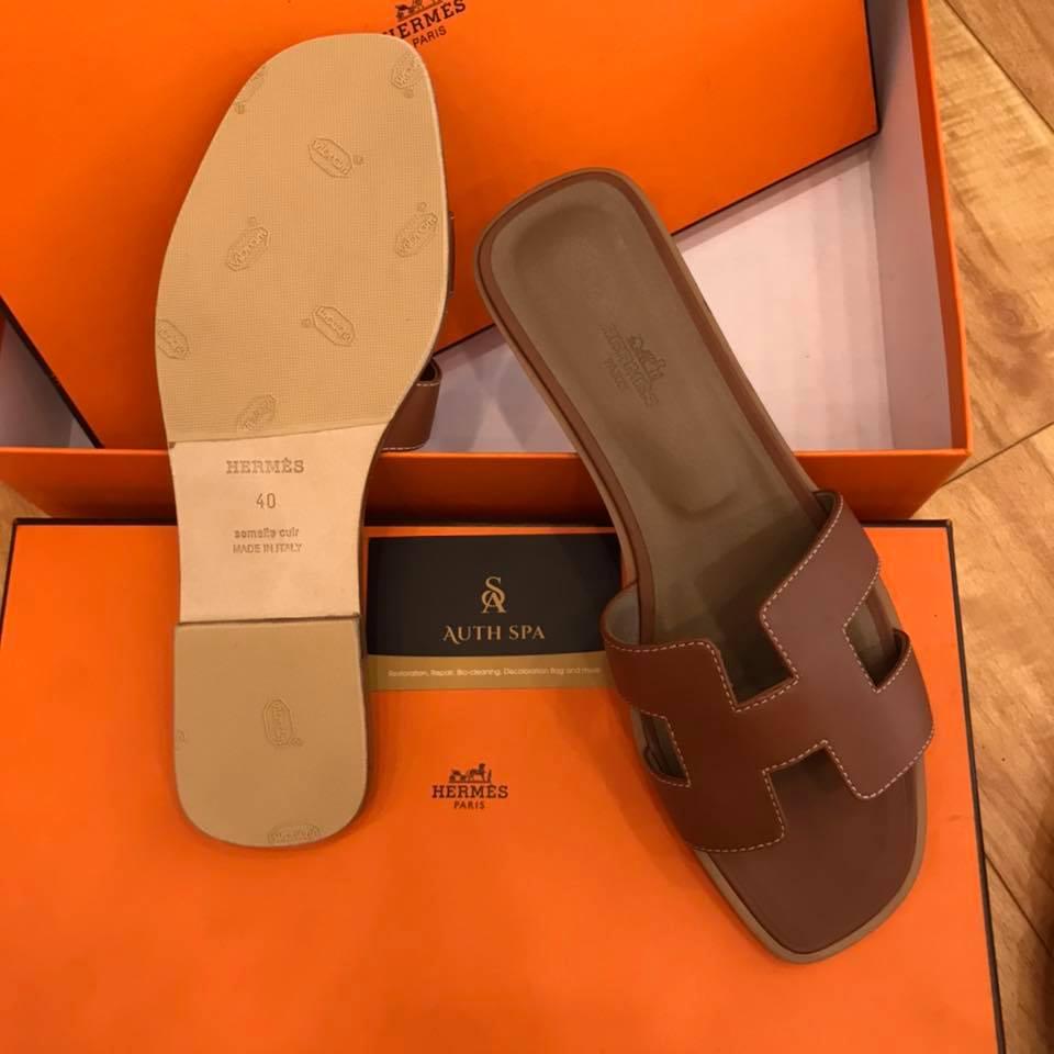 Dán đế giày dép Hermes 11